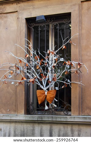 Handmade decoration on window for holidays - stock photo
