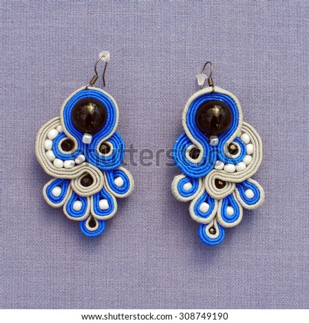 Handmade decupage earrings - stock photo