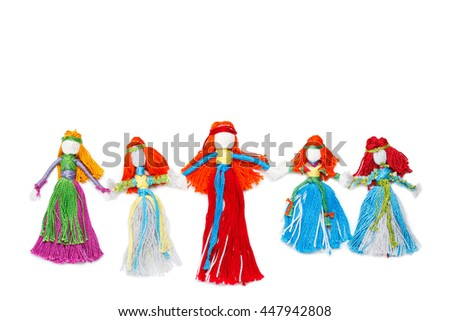 Handmade dolls holding hands on white. Family, mother and daughter, friendship concept - stock photo