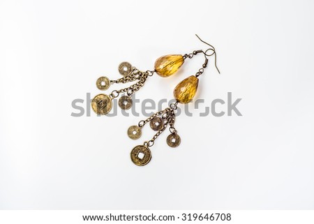 Handmade earrings jewelry made with antique gold and amber isolated on white background - stock photo