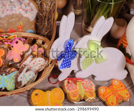 handmade Easter bunny colorful wooden toy and cakes - stock photo