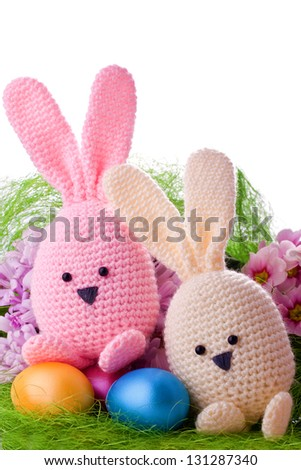 handmade easter bunny with colorful flowers and easter eggs - stock photo