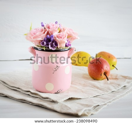 handmade flowers on a white background with pears  - stock photo