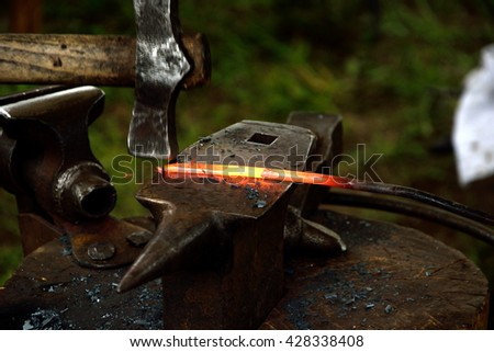 Handmade forging of the knife from heated iron piece