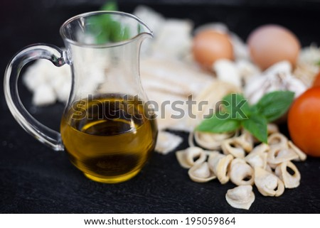 Handmade fresh pasta and olive oil - stock photo