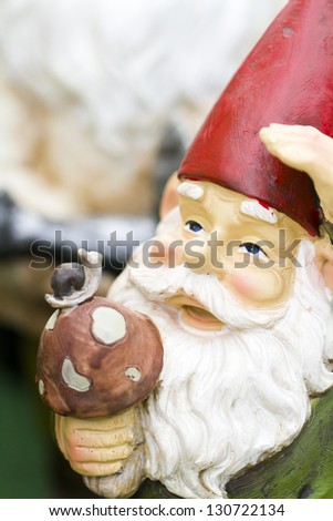 handmade garden gnomes on the display. - stock photo