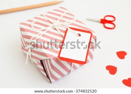 Handmade gift box  for valentine day on white background. - stock photo