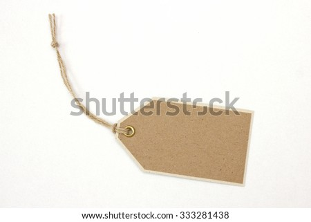 Handmade gift tag with twine on white background - stock photo