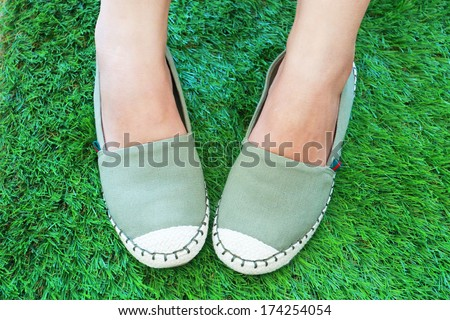 handmade green cotton shoes for girl - stock photo