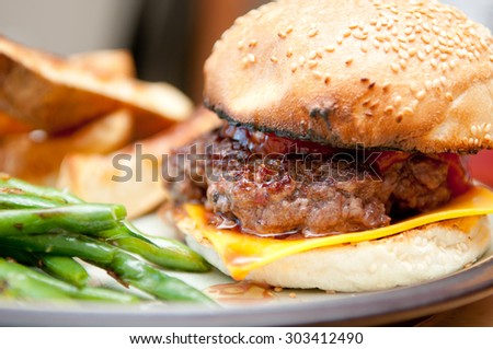 handmade hamburger with cheese and homemade wedge fries