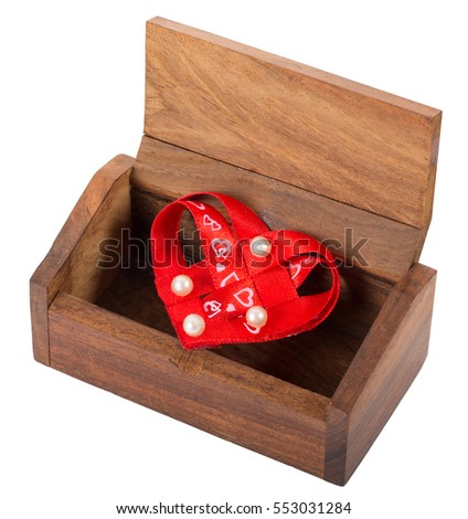 handmade heart in wooden box, isolated on white