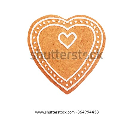 Handmade heart shaped gingerbread cookie isolated on white background