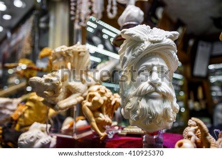 Handmade ivory products up for sale at the Grand Bazaar in the walled city of Istanbul (Turkey) - stock photo