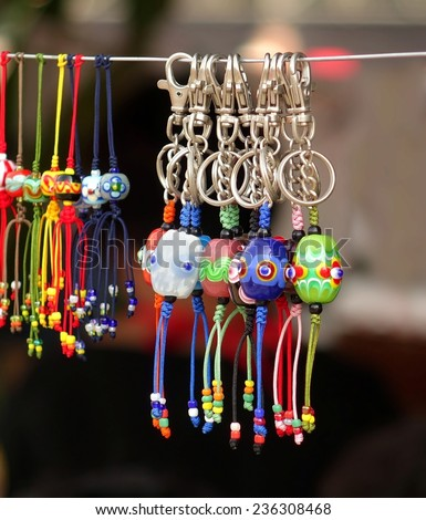 Handmade jewelry and keychains with colorful glass beads  - stock photo