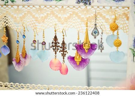 handmade jewelry made of epoxy resin - stock photo