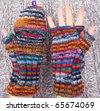 Handmade knitted striped mittens - stock photo
