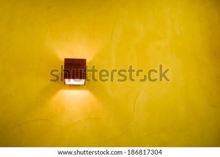 handmade lamp and yellow wall - stock photo