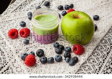 Handmade lip balm with the scent of apples and blueberries - stock photo