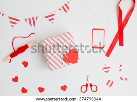 Handmade love gift  for valentine day on white background. - stock photo