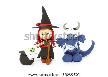 Handmade modelling clay red haired witch and blue dragon on white - stock photo