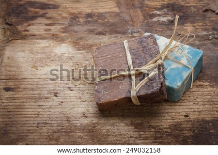 Handmade natural soaps on wooden background - stock photo