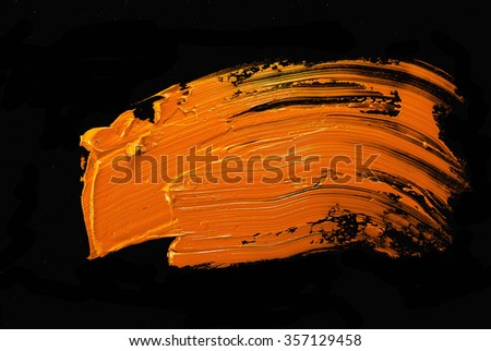 Handmade oil paint brush strokes isolated over the black background - stock photo