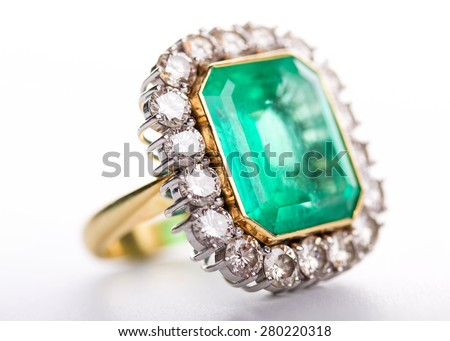 Handmade old gold ring with diamonds on white background. Small depth of field - stock photo