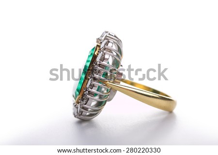 Handmade old gold ring with diamonds on white background. Small depth of field