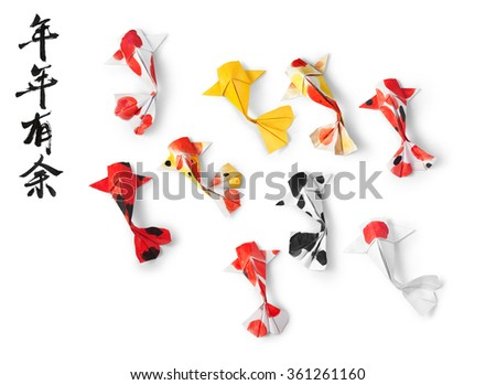 handmade paper craft origami koi carp fish on white background. Translation of text: May you have a prosperous new year.  - stock photo