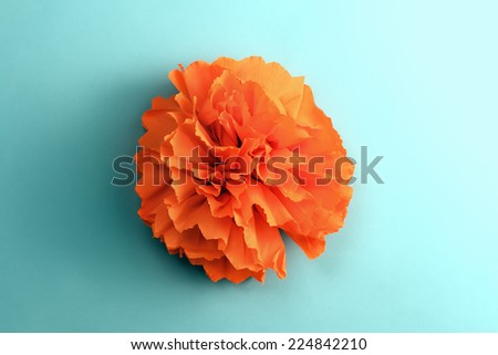 handmade paper flower on a glue background - top view - stock photo