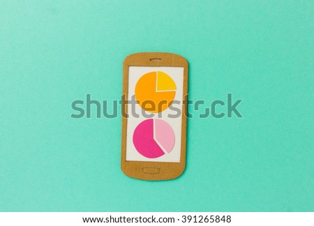 Handmade paper model of smartphone with pie charts - image concept for analytical apps, accounting, financial reporting, customer research - stock photo
