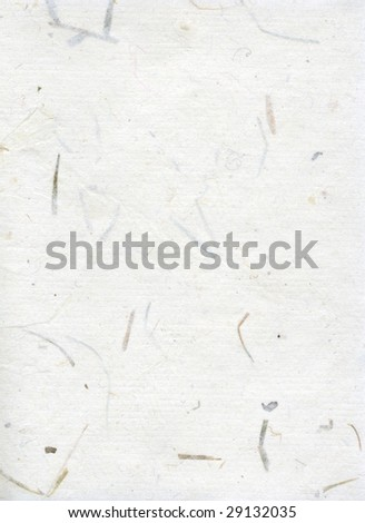 Handmade paper with twigs and leaves in it. - stock photo