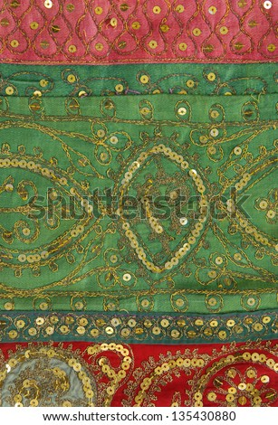 Handmade patchwork from India as background - stock photo