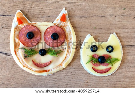 Handmade pizza in the form of cat. - stock photo