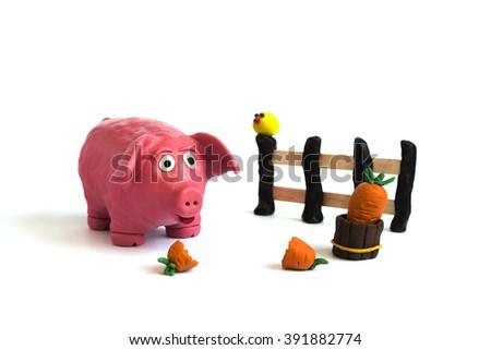 Handmade plasticine pig - stock photo