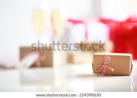 Handmade present boxes on a white table - stock photo
