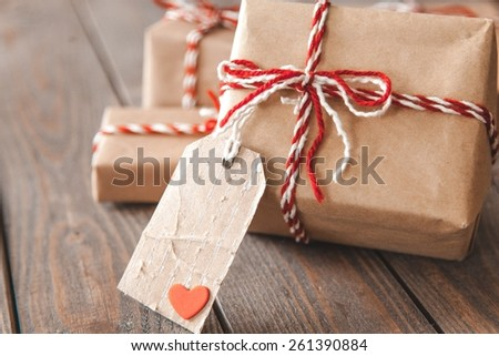 Handmade present boxes with tags and twine cord ribbons - stock photo