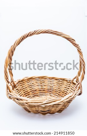 Handmade rattan basket on white background