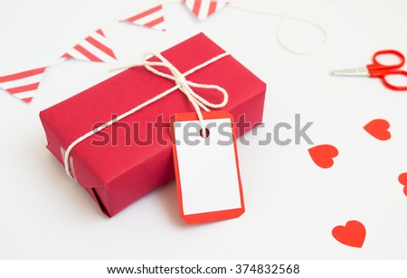 Handmade red gift box  for valentine day on white background. - stock photo