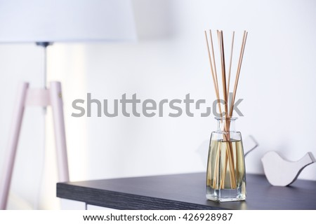 Handmade reed freshener on commode in living room, close up