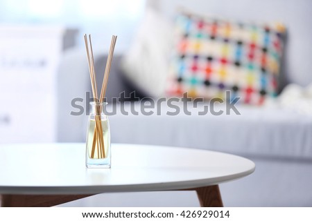 Handmade reed freshener on white table in living room, close up - stock photo