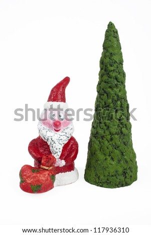 Handmade Santa Claus doll and xmas tree. Isolated - stock photo