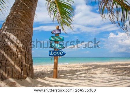 Handmade signpost on tropical beach in Thailand. Space for text. - stock photo
