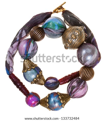 handmade silk woman necklace with bronze decoration isolated on white background - stock photo
