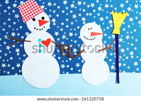 Handmade snowmen on bright background
