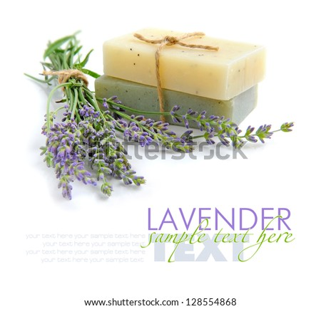 Handmade soap and lavender flowers on a white background - stock photo