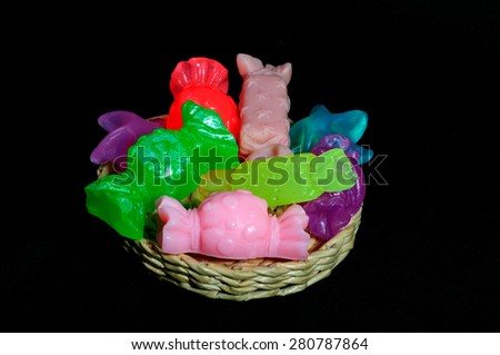 Handmade soap. In the form of candy. On a black background - stock photo