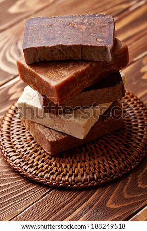 Handmade soap over wooden background