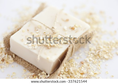 Handmade soap with oatmeal and milk on a white background - stock photo