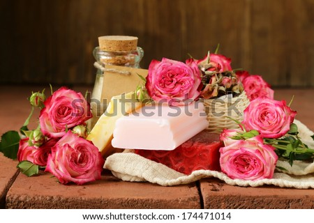 handmade soap with the scent of roses on a wooden table - stock photo